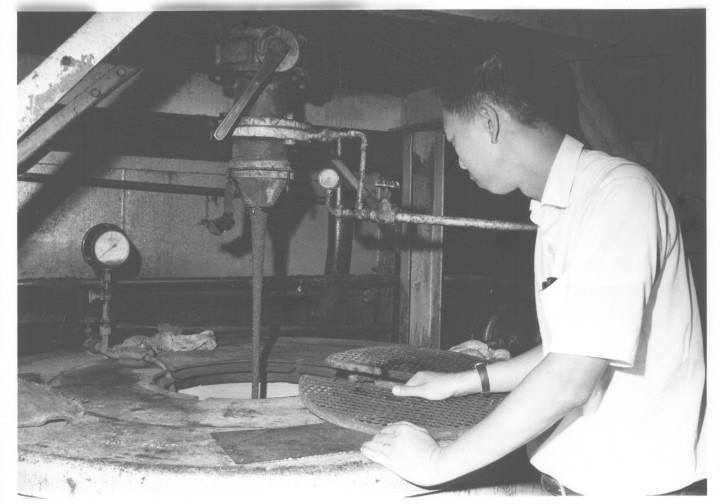 At the Khanh Hoi refinery of the Vietnam Sugar Company, near downtown Saigon, Director Vo Ngoc Truoc examines a centrifuge analyzing varieties of molasses, a by-product of sugar processing.