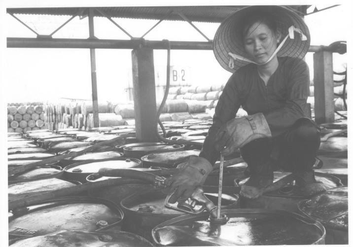South Vietnam Gears For Logistical Self-Sufficiency By Mid-1973 - Gasoline For Troops - An employee of South Vietnam's Fifth Area Logistics Command in Nha Trang fill gasoline drums for convoy shipment to military sub-depots and units throughout a seven-province area in Central Vietnam.