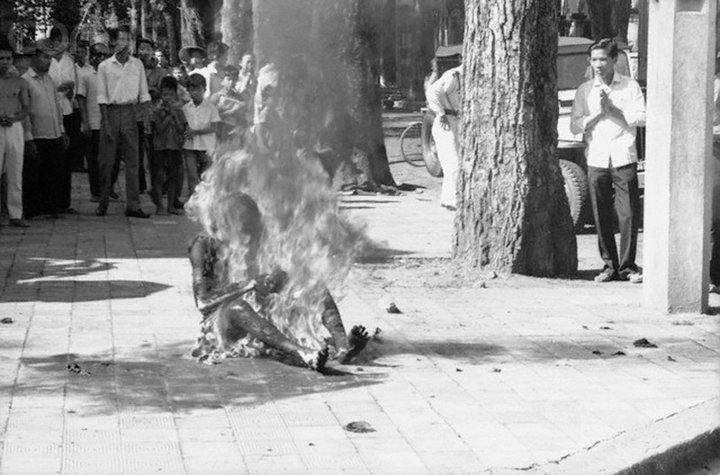 1963, Saigon, South Vietnam --- Flames engulf Buddhist Priest Ho Dinh Van in front of the Saigon Roman Catholic Cathedral here on October 27th, as people watch.  Hundreds witnessed the self-immolation---the seventh since last May, which was a protest against alleged anti-Buddhist policies of the Diem Government.  Observers here feel the ritual suicide was intended to coincide with the arrival at the Cathedral of the seven-man U. N. fact-finding team to ascertain if the anti-religious rumors are based on fact.  The motorcade carrying the U. N. team passed the church after the incident. --- Image by © Bettmann/CORBIS