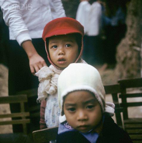 01 Mar 1973, Hanoi, Vietnam --- Vietnamese children with hats in a kindergarten near Hanoi in North Vietnam, photographed in March 1973. Photo: Werner Schulze | Location: Nghi Tam, Hanoi, Vietnam. --- Image by © Werner Schulze/dpa/Corbis © Corbis. All Rights Reserved.