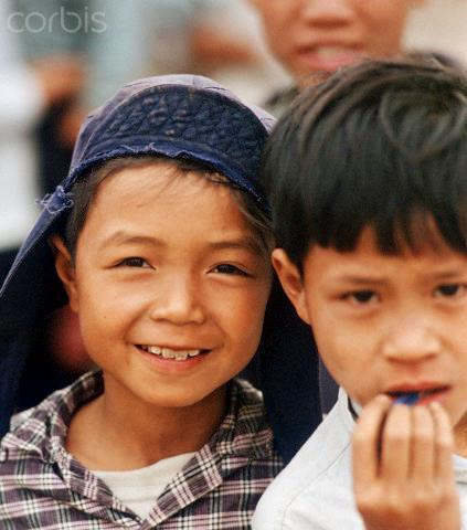 """01 Mar 1973, Hanoi, Vietnam --- Two little Vietnamese boys, photographed in March 1973 in North Vietnam. Only a few weeks before, the peace agreement was signed on the 27th of January in 1973 in Paris and the war against North Vietnam ended. The United States of America flew about 2,000 air attacks on cities and targets in North Vietnam during the """"Christmas bombings"""" in 1972. Photo: Werner Schulze --- Image by © Werner Schulze/dpa/Corbis © Corbis. All Rights Reserved."""