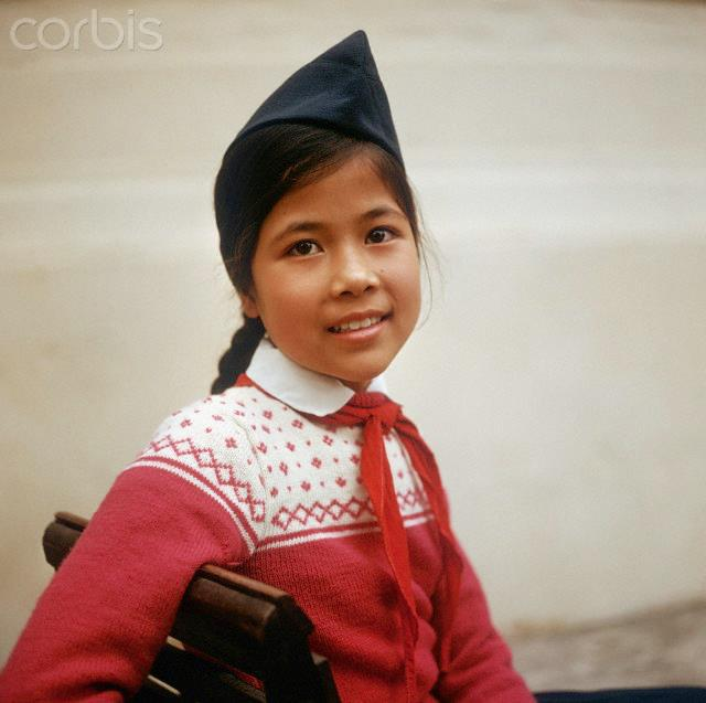 01 Mar 1973, Hanoi, Vietnam --- A Vietnamese girl with cap and red scarf, photographed in March 1973 in North Vietnam. Only a few weeks before, the peace agreement was signed on the 27th of January in 1973 in Paris and the war against North Vietnam ended. The United States of America flew about 2,000 air attacks on cities and targets in North Vietnam during the