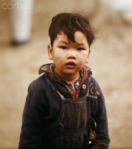 """01 Mar 1973, Hanoi, Vietnam --- A small Vietnamese boy, photographed in March 1973 in North Vietnam. Only a few weeks before, the peace agreement was signed on the 27th of January in 1973 in Paris and the war against North Vietnam ended. The United States of America flew about 2,000 air attacks on cities and targets in North Vietnam during the """"Christmas bombings"""" in 1972. Photo: Werner Schulze --- Image by © Werner Schulze/dpa/Corbis © Corbis. All Rights Reserved."""