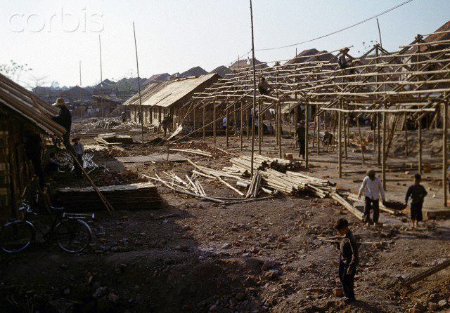 01 Mar 1973, Hanoi, Vietnam --- Provisional huts to live in are built in the war-destroyed area of Kham Thien, a part of Hanoi in North Vietnam in March 1973. The United States of America flew about 2,000 air attacks on cities and targets in North Vietnam during the