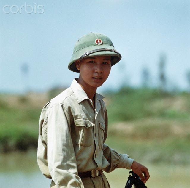 "01 Mar 1973, Vinh, Vietnam --- A Vietnamese soldier on a ferry near Hue, photographed in March 1973 in North Vietnam. The peace agreement was signed on the 27th of January in 1973 in Paris. The United States of America flew about 2,000 air attacks on cities and targets in North Vietnam during the ""Christmas bombings"" in 1972. Photo: Werner Schulze --- Image by © Werner Schulze/dpa/Corbis © Corbis. All Rights Reserved."